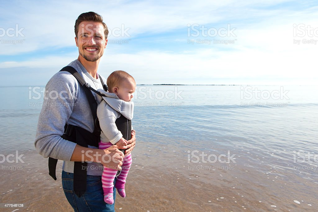 Father and Baby Daughter on Beach stock photo