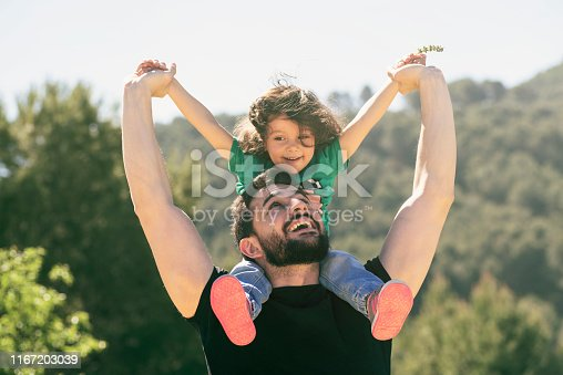 father and daughter playing outdoors in day light
