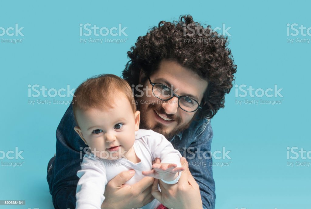 Father and baby girl portraits stock photo