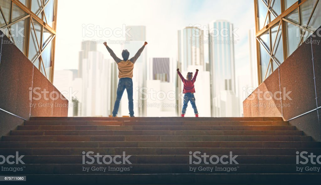 Father and child climb upstairs. 免版稅 stock photo