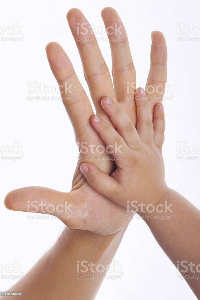 Father and child making hi-five gesture stock photo