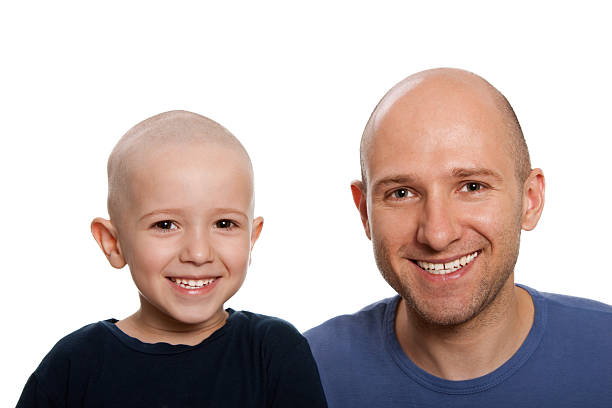 Father and child  shaved head stock pictures, royalty-free photos & images
