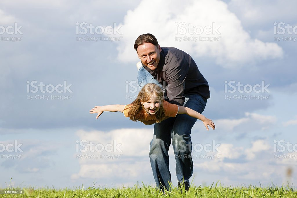 Father and child playing together royalty-free stock photo
