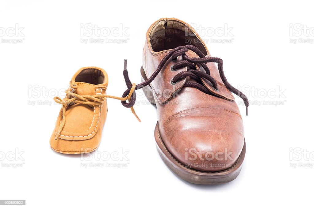 father and child shoes on white background stock photo