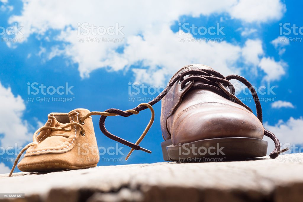 father and child shoes stock photo