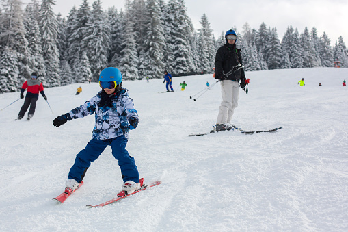 istock Father and child, skiing together in Austrian resort 1126183252