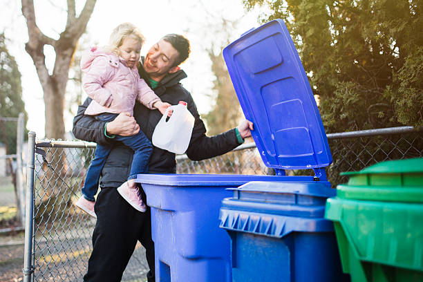 father and child taking out recycle trash - garbage bin stock photos and pictures