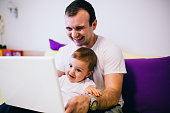 istock Father and child using laptop 600147242