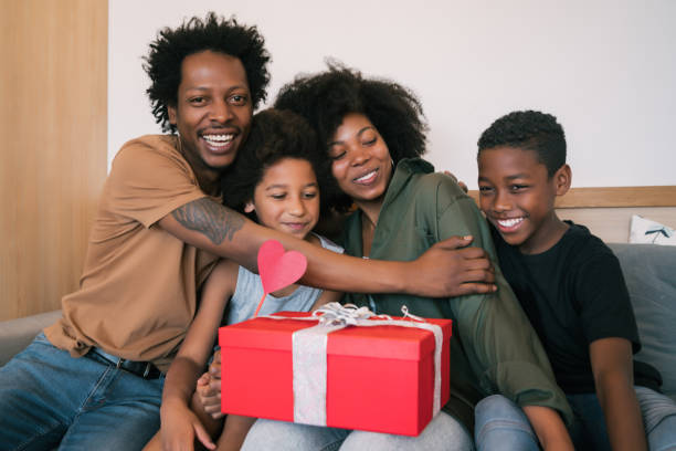 Father and children congratulate mother on mother's day. stock photo