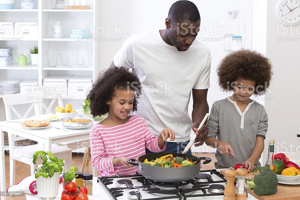 Father and Children Cooking Family Meal stock photo