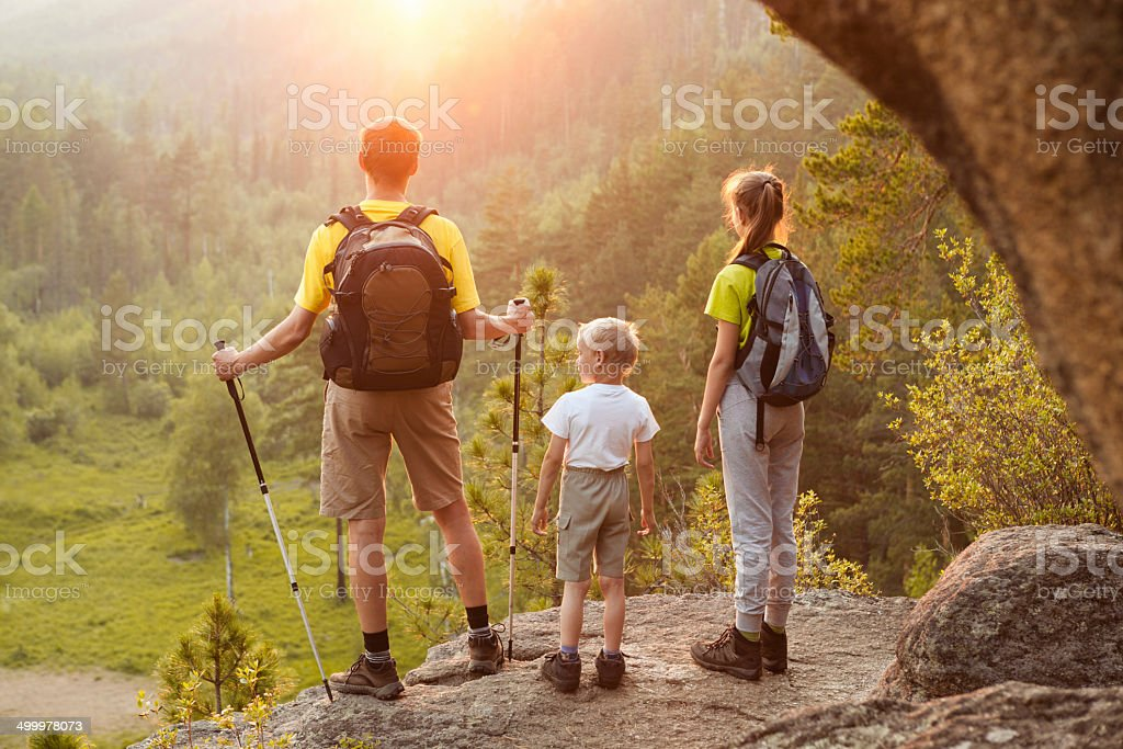 Father and children go hiking stock photo