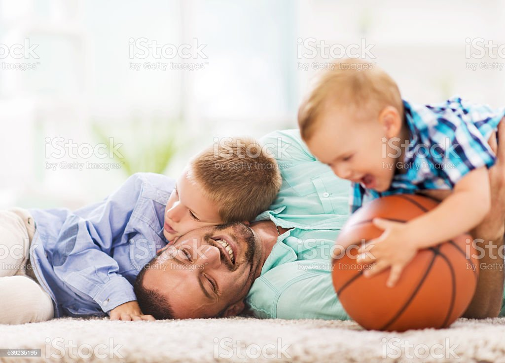 Father and children having fun at home. royalty-free stock photo