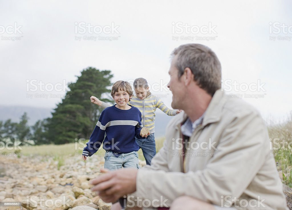 Father and children in remote area royalty-free stock photo