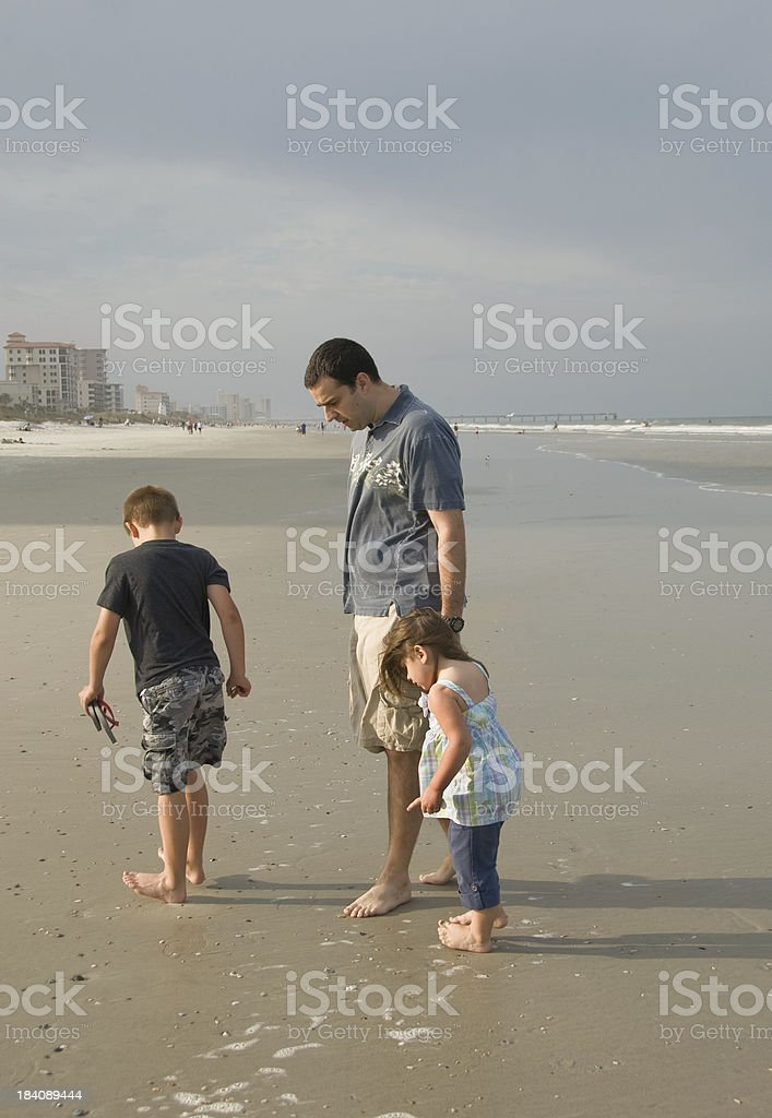 Father and Children Shelling stock photo