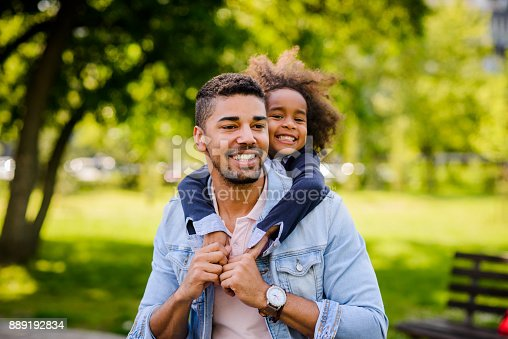 istock Father and daughte enjoying at the park. 889192834