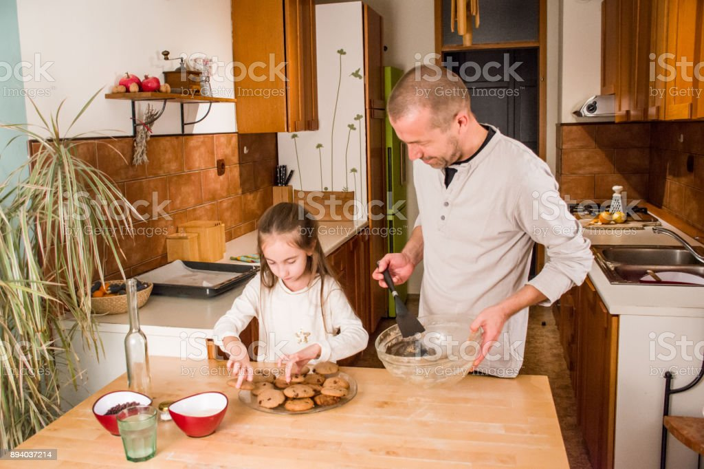 Father and Daughter Arangement Baked Cookies Together stock photo