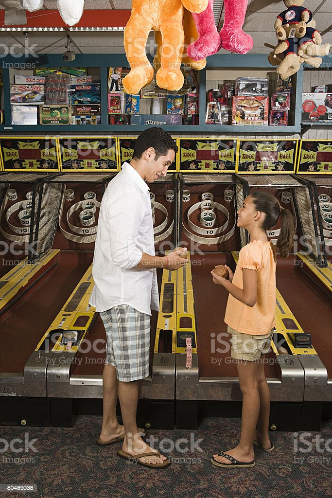 Father and daughter at amusement arcade 免版稅 stock photo