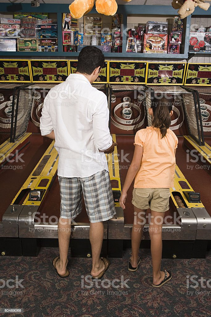 Father and daughter at amusement arcade royalty-free 스톡 사진