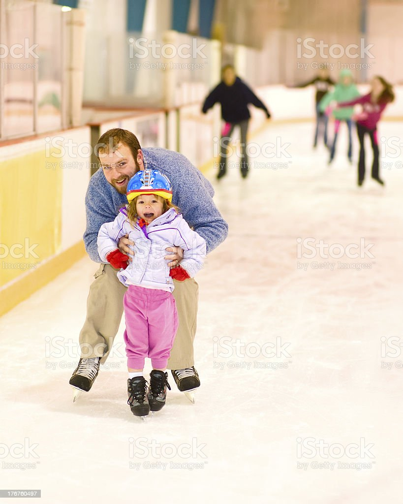 Father and Daughter at Ice Skating Rink stock photo