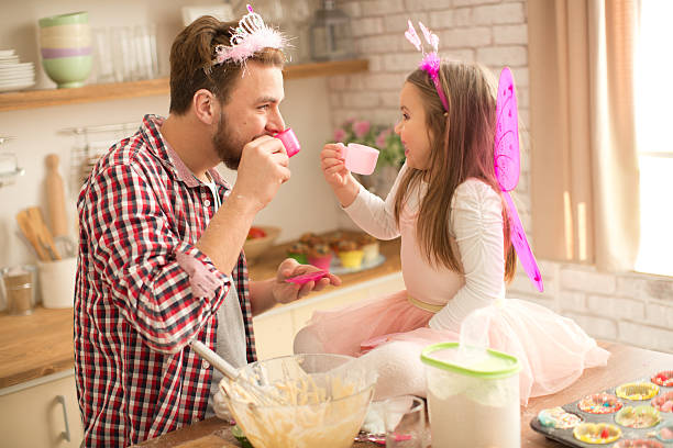 Father and daughter baking and having tea party in kitchen picture id467745966?b=1&k=6&m=467745966&s=612x612&w=0&h=wvaby2r1k7qdvpgquiyy8dph ij3dczuymxxmkdr5t8=