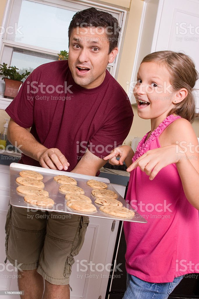 Father and daughter baking (series) royalty-free stock photo