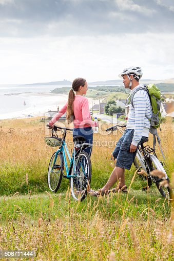 istock Father and Daughter bikeride 506711444