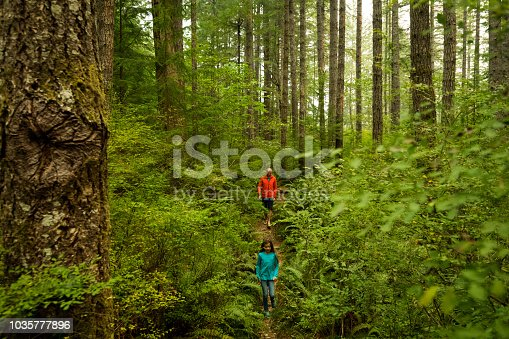 Father with young daughter exploring nature
