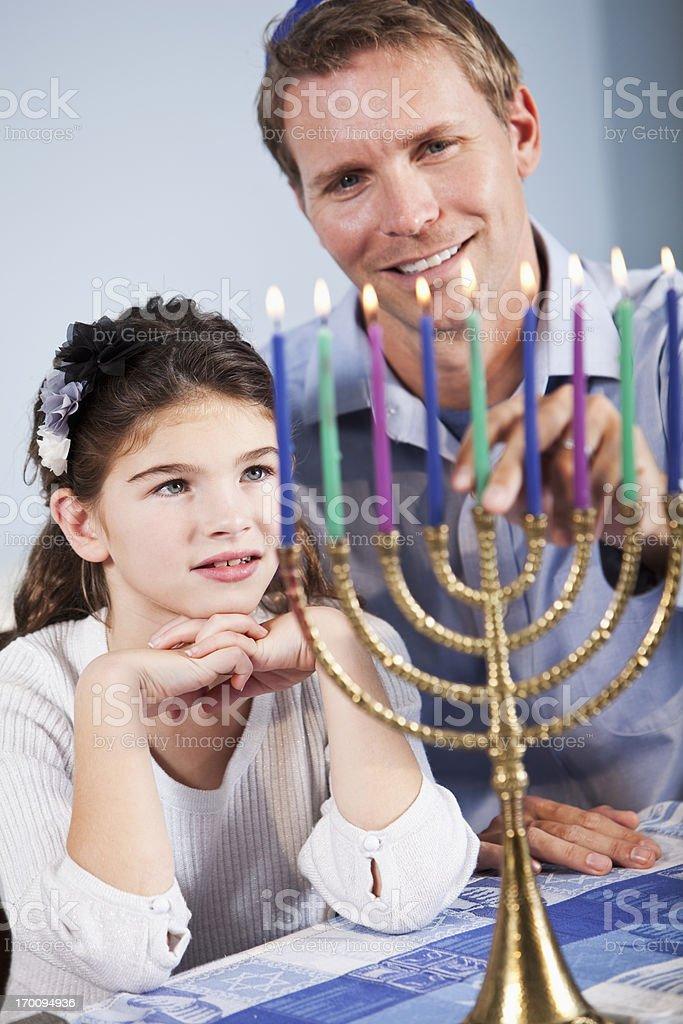 Father and daughter celebrating Hanukkah stock photo