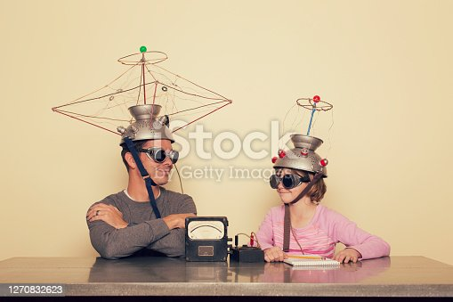 A father and his daughter communicate via a mind reading machine and telepathy to help understand one another. They are using a homemade invention to understand each others' minds.