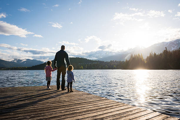 father and daughter connection - canada travel stock photos and pictures