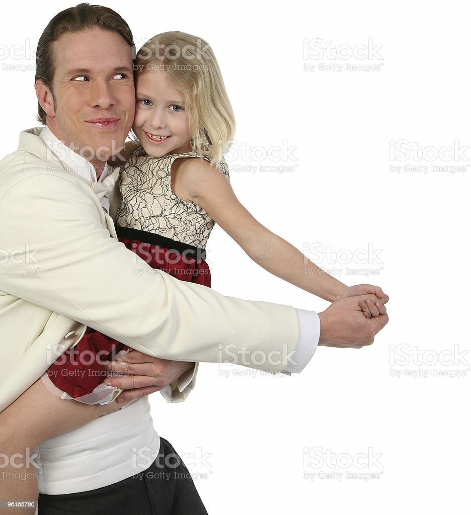 Father and daughter dancing in formals being silly royalty-free stock photo