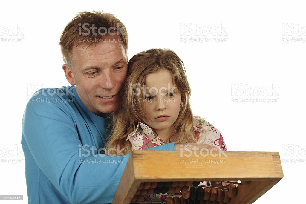 father and daughter doing maths royalty-free stock photo