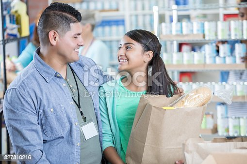 istock Father and daughter donate items during food drive 827810216