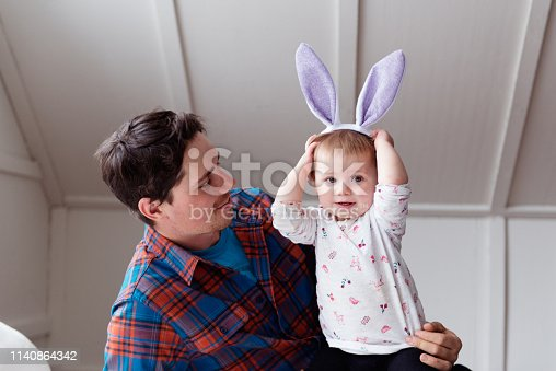 Father and his daughter during easter time.