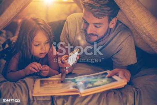 istock Father and daughter enjoying at home. 506677400