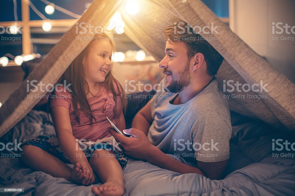 Father and daughter enjoying at home. royalty-free stock photo