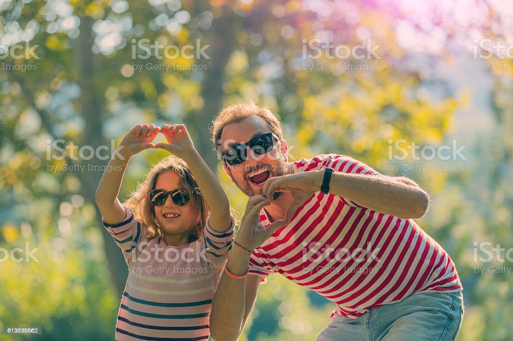 Father and daughter enjoying in the park. stock photo