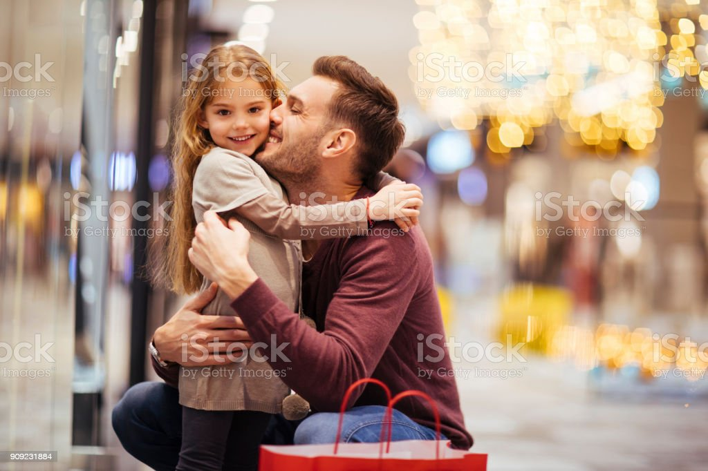Father and daughter enjoying shopping stock photo