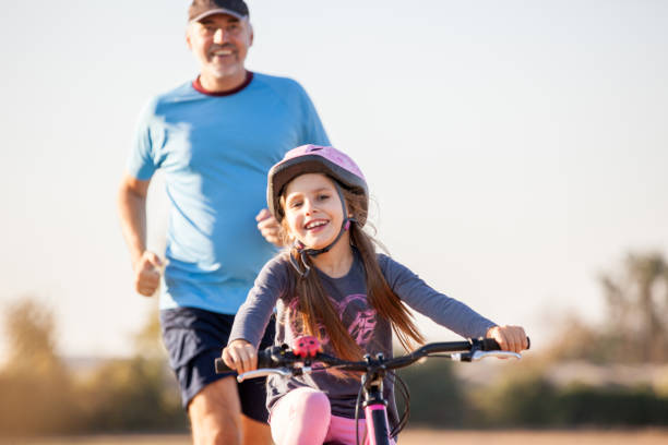 Father and Daughter Enjoying Sports Activity Outdoors stock photo