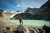 Father and daughter enjoying a stunning mountain backdrop in British Columbia's Coast Mountain Range
