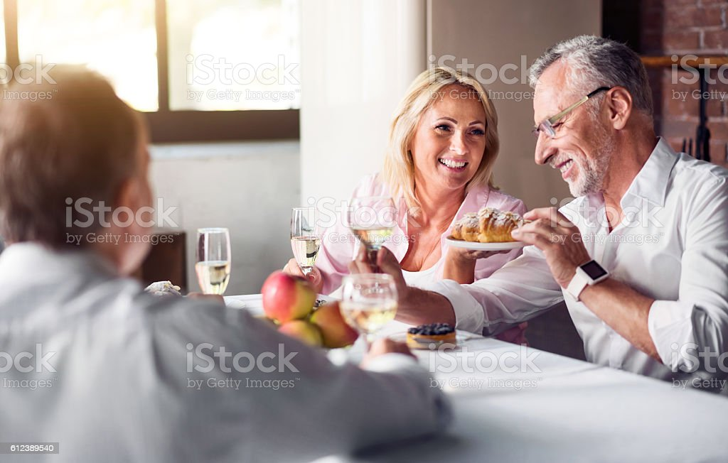 Father and daughter enjoying the meal stock photo