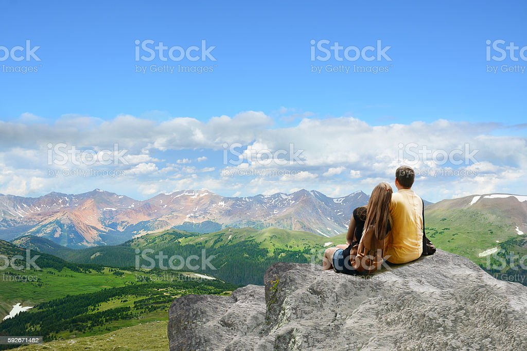 Father and daughter enjoying time together in mountains. stock photo