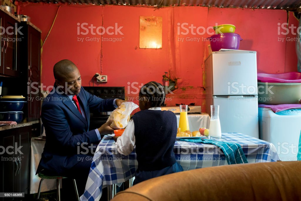 Father and daughter having breakfast together stock photo