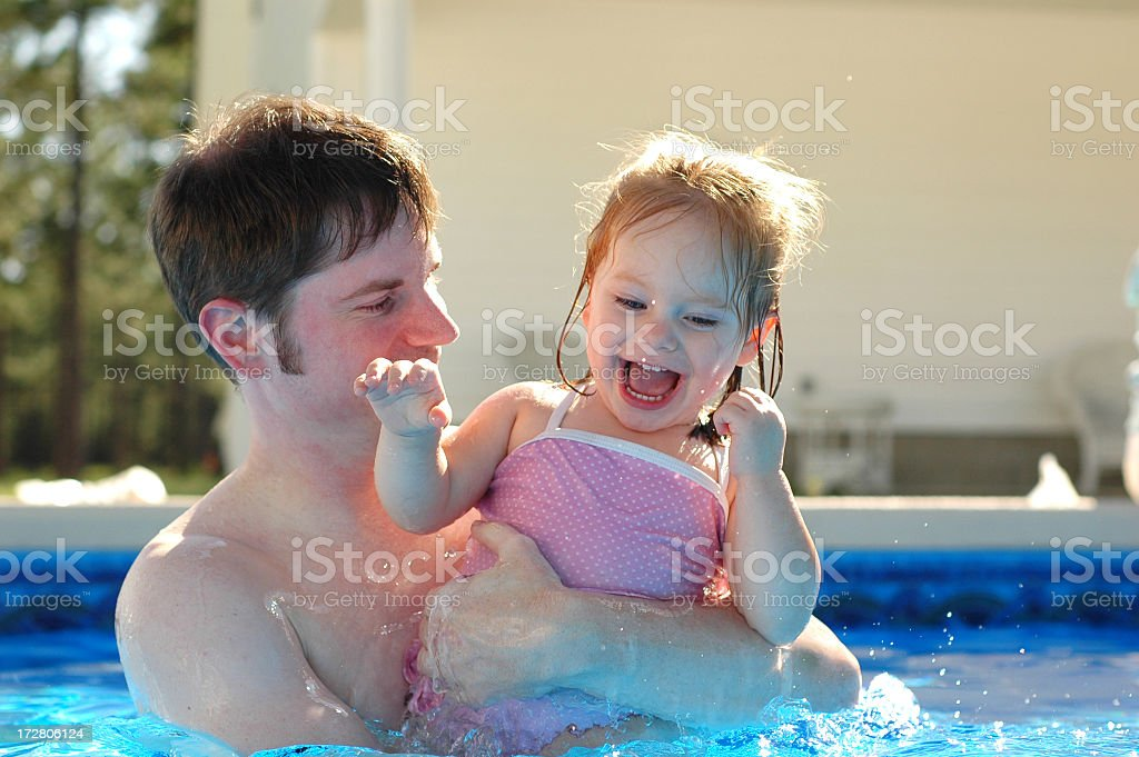 Father and Daughter Having Fun in Swimming Pool royalty-free stock photo