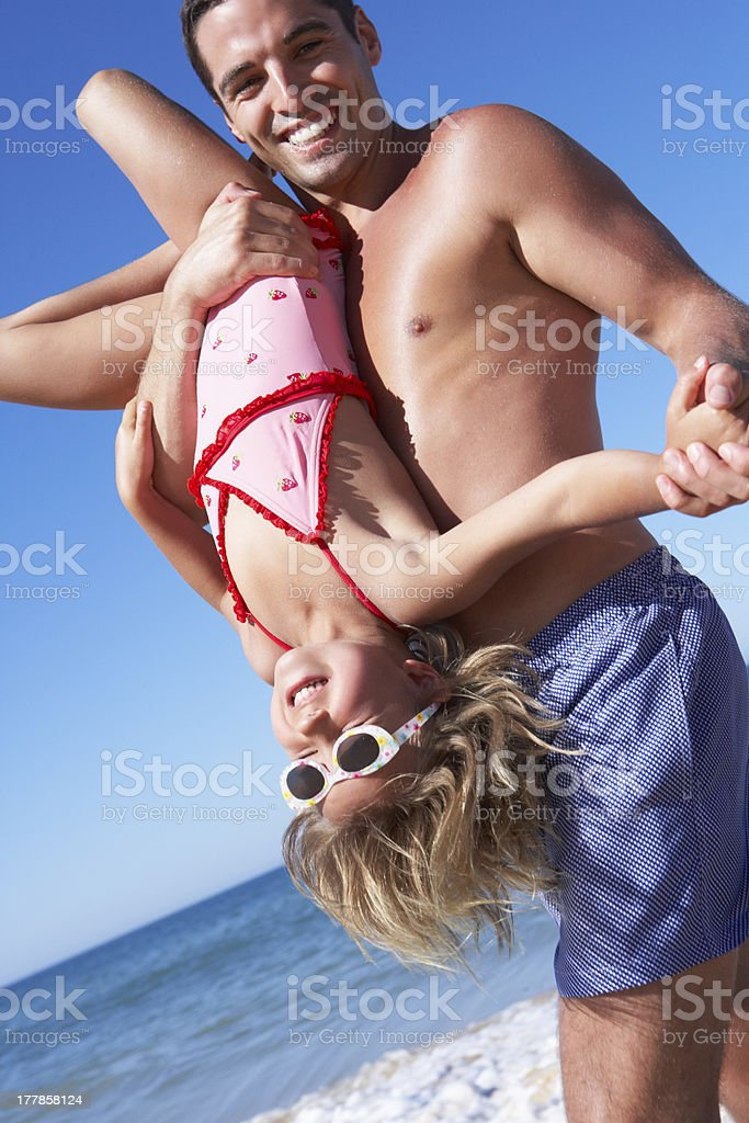 Father And Daughter Having Fun On Beach royalty-free stock photo