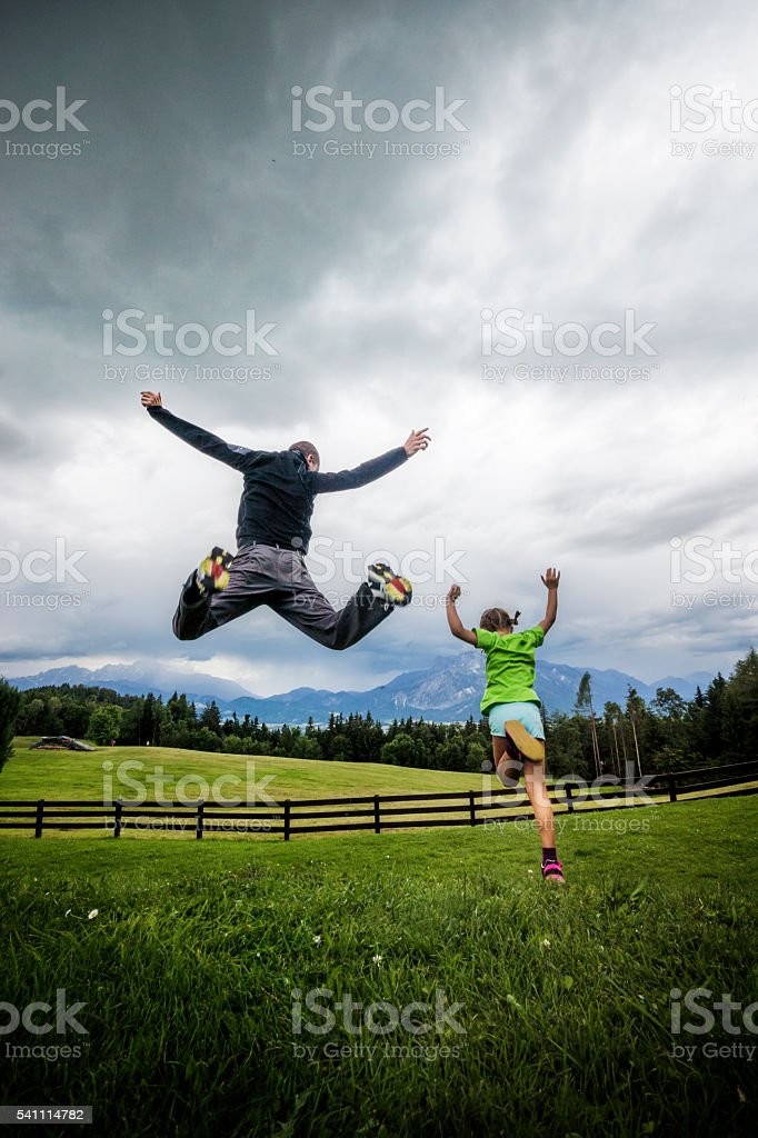 Father and Daughter Having Fun Outdoors stock photo