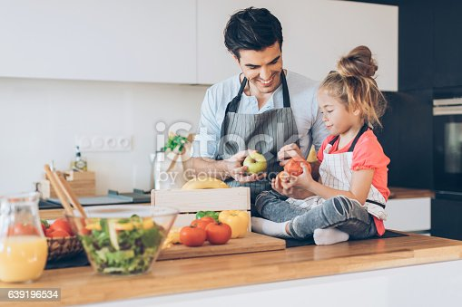 istock Father and daughter helping in the kitchen 639196534