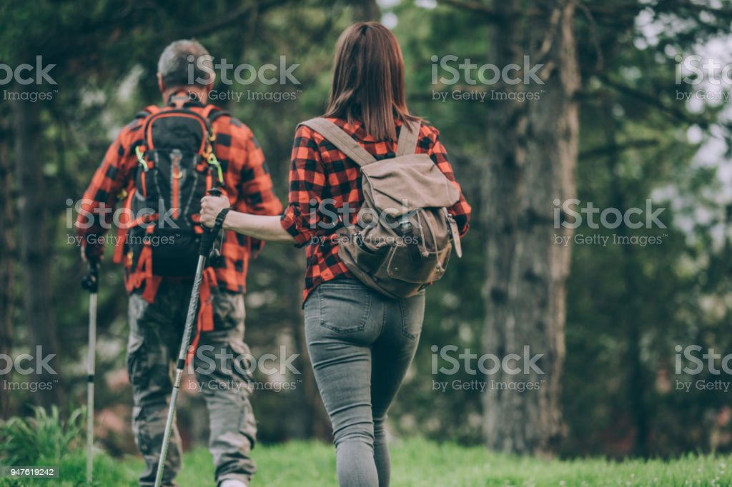Father and daughter hiking day stock photo