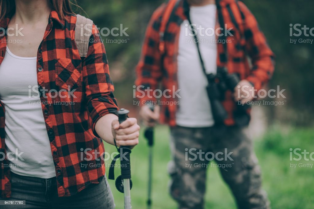 Father and daughter hiking on high mountain stock photo