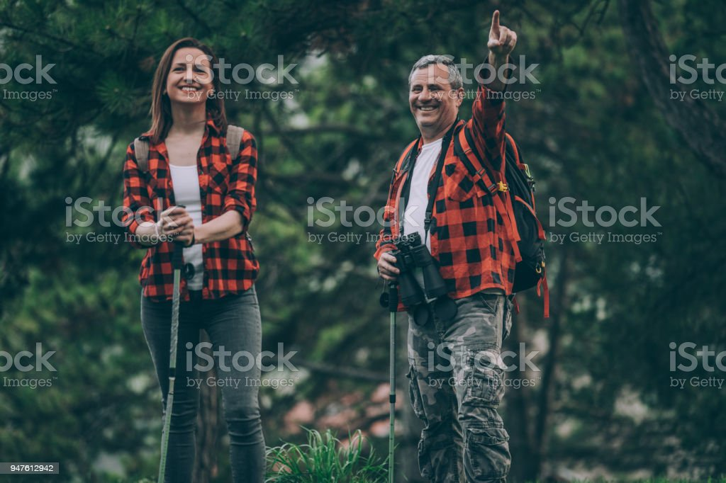Father and daughter hiking stock photo